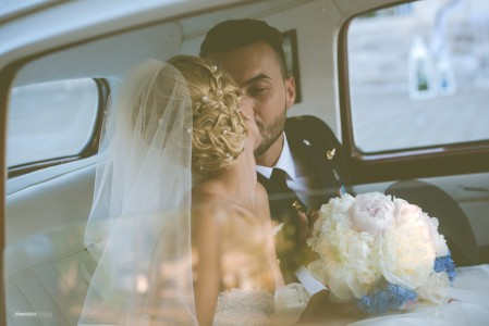 Vintage car kiss bride and groom